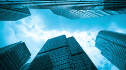 4k timelapse video of office buildings with clouds Stock Video Footage