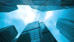 4k timelapse video of office buildings with clouds Footage