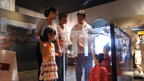 Asian Family In The Puppet Museum stock footage