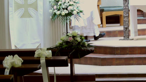 Priest's legs passing by the altar during Mass Footage