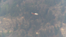 HD2009-8-1-18 Terr mtn forest fire helo and bucket follow Footage