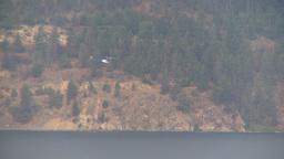 HD2009-8-1-20 Terr mtn forest fire helo filling bucket LL Stock Video Footage