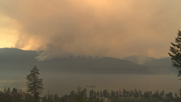HD2009-8-1b-1 forest fire from across lake Stock Video Footage