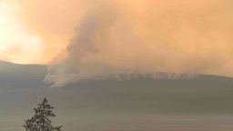 HD2009-8-1b-9 forest fire from across lake TL Stock Video Footage