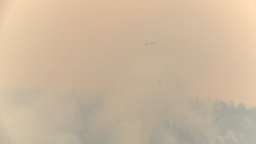 HD2009-8-1b-15 forest fire huey helicopter drop red... Stock Video Footage