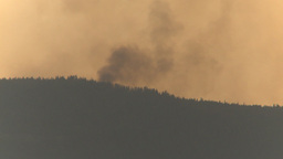 HD2009-8-1b-21 forest fire from across lake Stock Video Footage