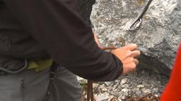 HD2009-8-4-2 rock climbing tyeingrope Stock Video Footage