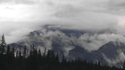 HD2009-8-8-5 clouds tearingalong mtn side TL Stock Video Footage