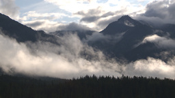 HD2009-8-8-11 clouds and mtns TL Stock Video Footage