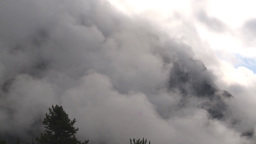 HD2009-8-8-15 heavy clouds and mtns TL Stock Video Footage