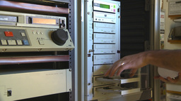 HD2009-8-17-1 Loading DVD duplicator Stock Video Footage