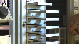 HD2009-8-17-3 Loading DVD duplicator Stock Video Footage