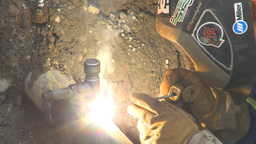 HD2009-8-20-10 gas pipe welding and brushing Stock Video Footage
