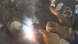 HD2009-8-20-10 gas pipe welding and brushing Footage