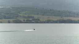 HD2009-8-22RC-2 seadoo on lake z reveal mtns Stock Video Footage