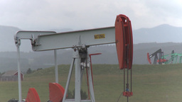 HD2009-8-22RC-8 pumpjacks 4 of them Stock Video Footage