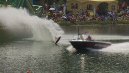 HD2009-8-23-22RC water ski comp female wipeout last sec Stock Video Footage