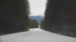 HD2009-12-3-6 winter drive on snow covered ro mtn road Stock Video Footage