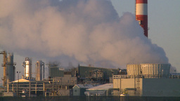 HD2009-2-1-27 Gas plant at sunrise stacks Stock Video Footage