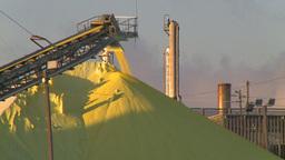 HD2009-2-1-29 sulfur pile at sunrise stacks Stock Video Footage