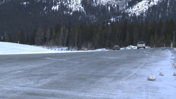HD2009-1-1-10 highway traffic snow rd mtns Stock Video Footage