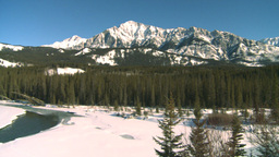 HD2009-1-6-11 river and snow mtns pan Stock Video Footage