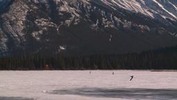 HD2009-1-6-27 kite skiers lake Mt Rundle Stock Video Footage