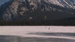 HD2009-1-6-29 kite skiers lake Mt Rundle Stock Video Footage