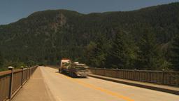 HD2009-7-1-3 transport truck over bridge Stock Video Footage