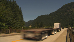 HD2009-7-1-5 transport truck over bridge Stock Video Footage
