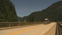 HD2009-7-1-7 transport truck over bridge Stock Video Footage