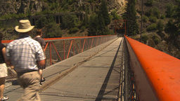 HD2009-7-1-33 people on suspension bridge canyon Stock Video Footage