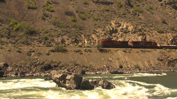 HD2009-7-2-1 frieght train above whitewater river Footage