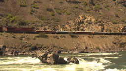 HD2009-7-2-1 frieght train above whitewater river Stock Video Footage