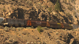 HD2009-7-2-3 frieght train arid hillside Footage