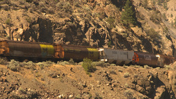 HD2009-7-2-3 frieght train arid hillside Stock Video Footage