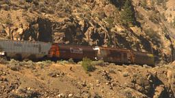 HD2009-7-2-3 frieght train arid hillside Stock Video Footage