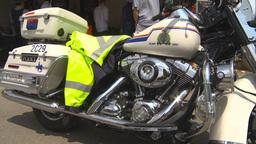 HD2009-7-3-13 Stampede RCMP motorbike 3shot Footage