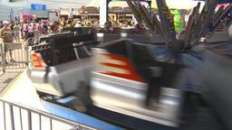 HD2009-7-3-17b midway rides kids 3shot Stock Video Footage