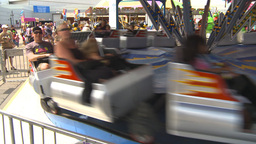 HD2009-7-3-17b midway rides kids 3shot Stock Video Footage