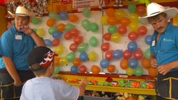 HD2009-7-3-29 midway balloon popping happy kid Stock Video Footage