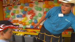 HD2009-7-3-29 midway balloon popping happy kid Footage