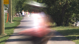 HD2009-7-8-16 bike walk path people TL Stock Video Footage