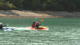 HD2009-7-12-1 kayakers race across lake Stock Video Footage