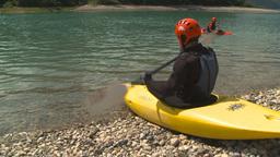 HD2009-7-12-3 kayaker enters lake Stock Video Footage