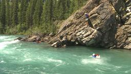 HD2009-7-13-17 risky jump into river rapids Stock Video Footage