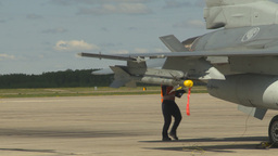 HD2009-6-1-31 F16s airman missle jet in bg Stock Video Footage