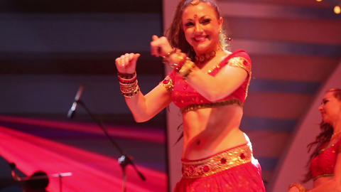 girl dancing on stage in a red national Indian sui Footage