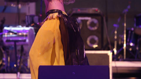 girl dancing on stage in a yellow black national I Footage
