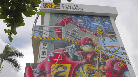 Pier-2 Art Center - Iron Man Taiwan Wide Pan stock footage